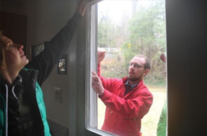 Volunteers in Buncombe Co., NC, weatherize a home.