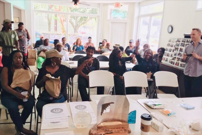 Community members in Charleston, SC, gather to discuss sustainability ideas.