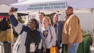 A photo of community members in Orlando, FL, working on relieving food deserts.