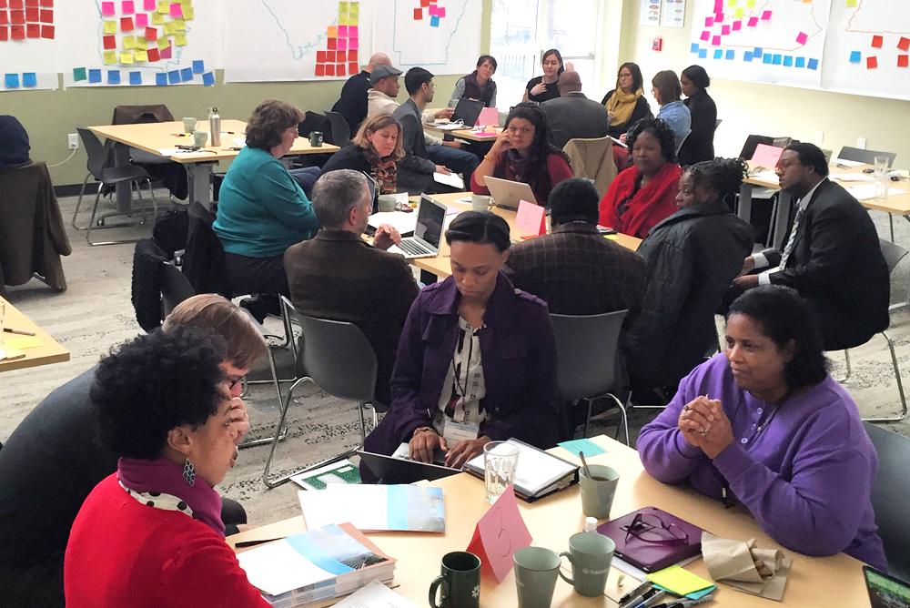A group of community members work on sustainability solutions in the South.