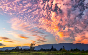 A photo of a sunrise sky over mountains for SSDN members Tennessee