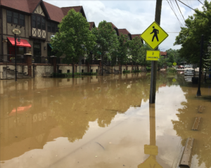 A photo of severe flooding in the Biltmore Village area of Asheville, North Carolina.