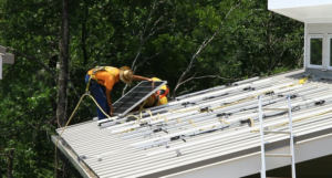 A worker installs energy efficient products in the Tennessee Valley
