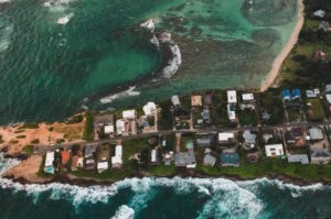 An aerial photo of coastal residences and businesses threatened by climate change in Florida.